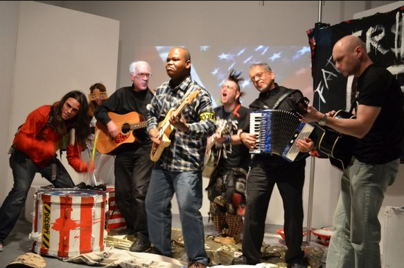 "The Occuponics Perform in a worldwide streamcast of The People Staged ""Father$ of Lies."" Photo credit: Stacy Lanyon."